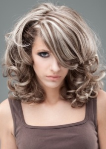 beauty portrait of blonde woman in 60s style make-up and hairstyle